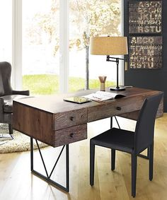 Crate & Barrel's Hendrix desk is made from reclaimed wood and solid black walnut with a welded steel base. http://www.crateandbarrel.com/