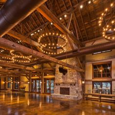 Wood beams, chandeliers, stained concrete color! Kendalia Barn Event Venue - Heritage Restorations