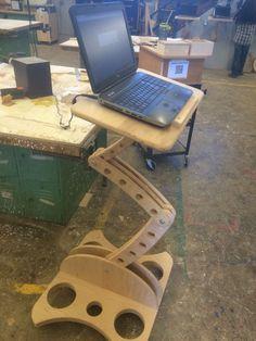 Wryland's Adjustable computer work station.