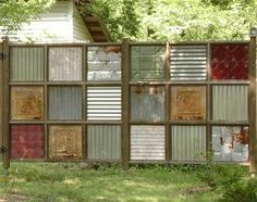 This would be perfect to block out the idiot neighbors.    Salvaged tin painted different colors for the basement wall. you could also Flip over and add glass top and make a table. made from old pallet wood, and salvaged tin and ceiling panels