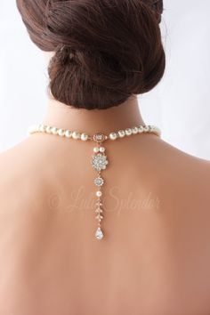 I have handmade this lovely necklace. It features a delightful and unique back drop which hangs prettily from the handmade and hand set swarovski