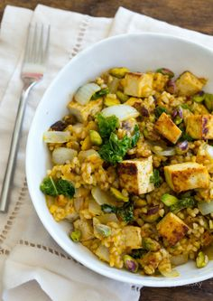 Pumpkin, Pistachio & Kale Fried Rice with Maple Tofu - Barbie says: This is one the best vegan dishes I've ever had. Our changes were to increase the spices, use roasted unsalted pistachios instead of raw, and to cook the tofu separately. This was so good I caught the carnivorous boyfriend eating leftovers out of the pan with his hands lol.