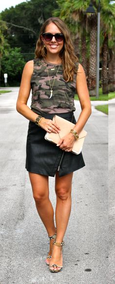 Camo top with leather skirt and python shoes
