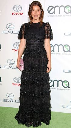 JESSICA BIEL in an embellished black dress with lace detailing, plus a bubblegum pink clutch, at the Environmental Media Awards in Burbank, Calif.