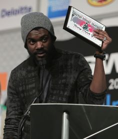 Snapshot: March 13 - Gary Clark Jr.     - Now that's a nice welcome-home gift. Austin, Texas, native and recent GRAMMY winner Gary Clark Jr. accepts the Best Blues Act award at the 32nd Annual Austin Music Awards at South by Southwest on March 12
