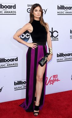 Lily Aldridge in a Balmain dress from the F/W 15 collection, Jennifer Meyer cuffs and ring, Edie Parker clutch, and Guiseppe Zanotti heels at the 2015 Billboard Music Awards.