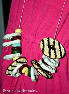 Snack Necklace  My BF and I sat and made several of these one night before the elementary movie night. We used gummy life savers, fruit loops, white and chocolate covered pretzels and the keebler cookies shown.  The kids LOVED them.
