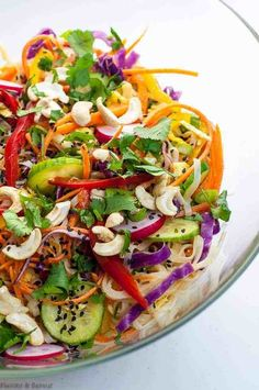 Crisp peppers, cabbage, carrots and cucumber, crunchy peanuts are all tossed together with rice vermicelli and a spicy Thai-style peanut sauce in this Super Crunchy Thai Noodle Salad. Vermicelli Salad, Baked Fish Tacos, Thai Noodle Salad, Spicy Thai Noodles, Easy Steak Fajitas, Linguine Recipes, Thai Salads, Spicy Peanut Sauce, Coleslaw