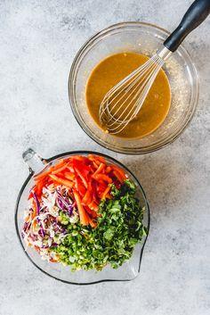 Asian Slaw with Ginger Peanut Dressing Vegan Coleslaw vegan coleslaw recipe with peanut dressing Asian Slaw Salad, Vegan Coleslaw, Asian Salads, Peanut Recipes, Slaw Recipes, Ginger Asian, Asian Dressing, Bowls, Dressings