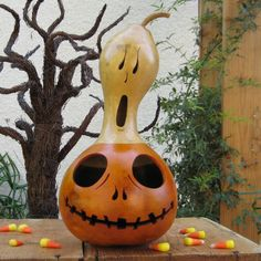 Halloween Gourd Jack O Lantern Ghost Top Natural Spooky Centerpiece Decoration (with removable top). $21.00, via Etsy.