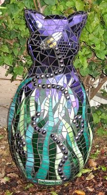 Mosaic cat. This gives me an idea...why not take an imperfect sculpture (chipped etc) and cover it w glass tiles or broken dishes?!!