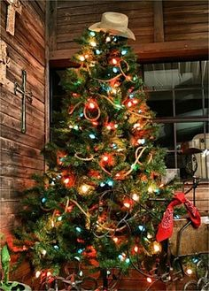 Western Themed Christmas Tree  complete with rope garland, bandanas, and cowboy hat tree topper! ~ 20 Awesome #ChristmasTree Decorating Ideas & Inspirations - Style Estate -