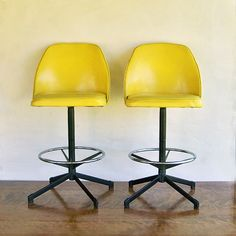 two mid century modern bar stools bright yellow by