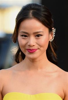 "At the premiere for ""Godzilla"" in Los Angeles on May 8, 2014, Jamie Chung opted for a blinged-out floral ear cuff that complemented her feminine yellow frock and red lip. Like us on Facebook?"