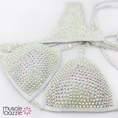 This white crystal competition bikini features 'crystal AB' crystals on a white hologram fabric. White Crystal Competition Bikini - CB053. #muscledazzle #competitionbikini #crystalbikini #bikinicompetition #inbabikini #bikinicompetitor #bikinifitness #fitnessbikini #competitionsuits #competitionbikinis #ifbbprobikini #compsuit #ifbbpro #bikinifitnessmodels #bikinisuit #npc #contestprep #wbff #competitionsuit #npcbikiniprep