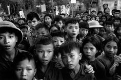 https://flic.kr/p/FaomHz | North Vietnamese Children 1969 - Photo by Marc Riboud | North Vietnam. 1969. Children coming out of a small village school on the coast. As their astonished gazes well prove, they have rarely seen a Westerner.