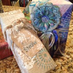 Homemade gift wrapping paper by Claire: stencils on mop up paper.