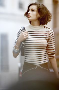 Nine d'Urso wears a button shoulder striped top. Simple and chic
