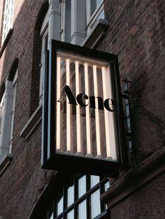 Acne signage: layered illuminated glass box with black frame shop signage, retail signage, Shop Signage, Retail Signage, Wayfinding Signage, Signage Design, Led Neon, Habitat Collectif, Blade Sign, Licht Box, Sign Board Design