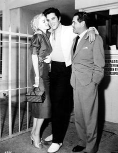 Producer Pandro S. Berman with Elvis Presley near the MGM or Paramount Studio gates (location not confirmed) around the time of Jailhouse Rock (film released 1957); also pictured is actress Barbara Lang who was originally slated to appear opposite Presley in Jailhouse Rock (but the part ultimately went to Judy Tyler)