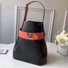 Louis Vuitton Two-tone Epi Leather Twist Bucket Bag Black/Orange 2019