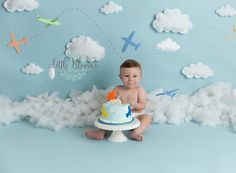 Airplane, adventure, first birthday cake smash, hanging clouds, airplane cake