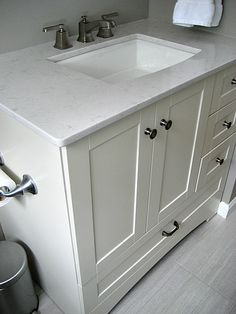 Home Depot St Paul Manchester Vanity pairing with a Silestone Lagoon Countertop, Kohler Archer Sink and Moen Faucet.