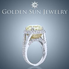 GOLDEN SUN JEWELRY: A beautiful diamond engagement ring featuring an elegant split diamond band that leads to a diamond halo. You will see the 7.07ct. Fancy Yellow VVS Ascher cut diamond. Beneath is the accenting yellow gold basket with canary yellow pave diamonds. #engagement #engagementring #engaged #wedding #weddingring #married #bride #bridetobe #fancyyellow #canary #bridal #fashion #fashionista #designer