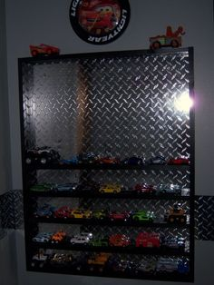 cool shelf; My husband would LOVE this type of shelf, being a mechanic, NASCAR, and overall vehicle guy.. he'd put his grown-up car collection in it lol