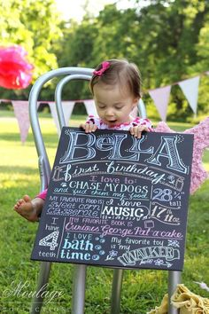 First Birthday photo shoot with her favorite things written on a chalkboard!