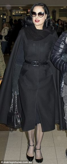 Repeat offender: On Monday,  Dita Von Teese proved that you can recycle an outfit as she made her way through Sydney Airport in her favourite black coat dress (L), the same she wore earlier this month (R)