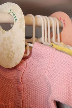 I separated my girl's clothes with shower curtain hooks but even if you use a different colored hanger or a piece of masking tape it helps to not miss your child fitting into an outfit - but don't just go by the size on the clothes.