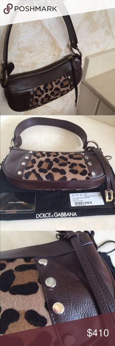 "🌺🆕D&G prized possession bag Authentic Dolce & Gabbana Brown Leather pouchette with leopard print real pony hair and silver nail heads and trim. Same on both sldes. Zip top- clean interior. Short shoulder  Excellent condition - like new. Dust bag and 2 authenication cards included. This is a ""WOW"". Not eligible for bundle. Dolce & Gabbana Bags"