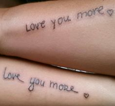 Matching mother/daughter tattoos...each other's writing
