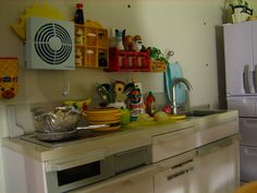 kitchen (cute, cluttered).