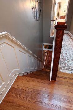 The Old Town Home's version of the wainscoting with built-in handrail ~ great remodel pics