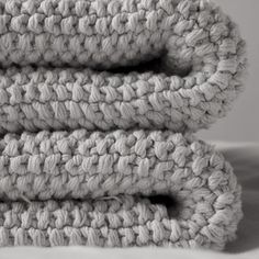 Knot is a unique hand knit throw produced by a collective in South America who are dedicated to improving the lives of women by sharing their hand-knit products with the global market. One Knot throw is knitted by three to four women working together o Touch Of Gray, Textiles, Knitted Throws, Natural Texture, Merino Wool Blanket, Warm And Cozy, Hand Knitting, Knit Crochet, Crochet Winter
