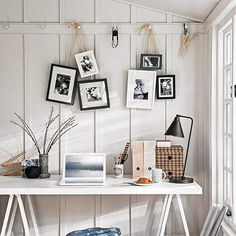 Fix a bunch of frames to lengths of rope or twine, tie 'em together and hang 'em from a peg