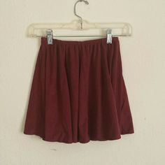 BM skirt LIKE-NEW Burgundy/maroon Brandy Melville shirt, size small. Is a suede-like fabric. Only worn once. About 14 inches long Brandy Melville Skirts Mini