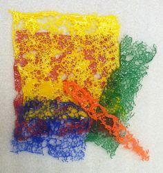 Sifting powders on fiber paper: Fused Glass Class | Washington Glass Studio