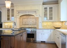 I like this kitchen's style.  Great cabinets, awesome stove/oven and a circular flow.  VERY nice.