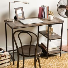 Carve out a personal workstation in any corner of your home withthis Renate writing desk. Featuring a compact size, this desk fitsneatly into small spaces. Two integrated shelves provide storagespace