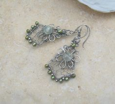 sterling silver earrings with prehnite and pearl .. not yet listed.. interested?? let me know ..$58