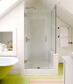 A glass-enclosed shower preserves the room's openness, and tucking it under the eave allows room for storage and a wide walkway. The built-in storage cubby adds functional space to a bathroom that could use a little more storage. #walkinshower #walkinshowerideas #bathroommakeover #showerideas #bhg Open Bathroom, Small Bathroom With Shower, Large Shower, Upstairs Bathrooms, Bathroom Renos, Bathroom Green, Master Bathroom, Shower Bathroom, Beach Bathrooms