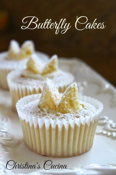 "Christina's Cucina: light and delicate cupcakes hide a jam and cream filling below the ""butterfly"" dusted wings on top!"