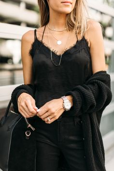 Lacey black silk cami and bold layered necklaces