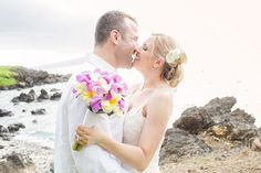 """""""Laughter is the fireworks of the soul"""" -- image of Bliss newlyweds by Love and Water Photography - bouquet by Petals -- Kukahiko Estate, Maui, Hawaii"""