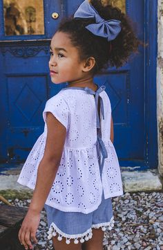 Family time is all about the sweet details! We love this tie-back eyelet lace shirt and pom-pom chambray shorts! LAKE HOUSE releases January 14th at 7am CT!