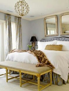 Soothing Color Scheme  Steely Gray + Honey  This master bedroom uses a soothing blend of cool grays and warm golden-honey hues. The harmony of these tones is perfect for relaxation. Gray walls and an upholstered headboard set the stage for the space, while the golden notes are struck on metallic pieces such as the light fixture, bench frame, and bedside lamp. The hues combine in the silk draperies and bed skirt. Additional texture and color is offered by the nubby decorative pillow and…