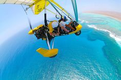 Hanging out of a microlight at 3000ft over the Ningaloo Reef, WA